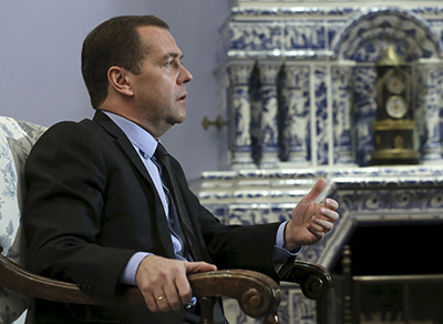 Russian Prime Minister Dmitry Medvedev speaks during an interview at the Gorki state residence outside Moscow, Russia, February 11, 2016. Medvedev raised the spectre of a permanent or a world war if powers failed to negotiate an end to the conflict in Syria and warned against any ground operations by U.S. and Arab forces. REUTERS/Ekaterina Shtukina/Sputnik/Pool ATTENTION EDITORS - THIS IMAGE HAS BEEN SUPPLIED BY A THIRD PARTY. IT IS DISTRIBUTED, EXACTLY AS RECEIVED BY REUTERS, AS A SERVICE TO CLIENTS.
